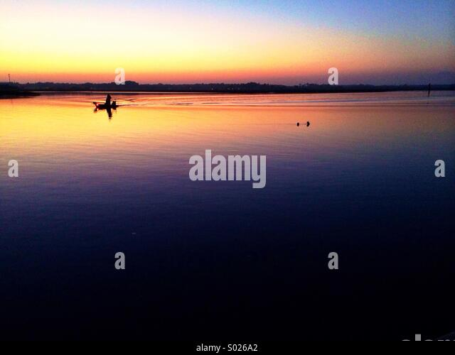 Sunset Fishing - Stock Image