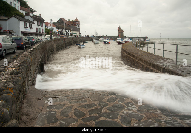 High spring tide at Lynton harbour on the North Devon coast, England, United Kingdom - Stock Image