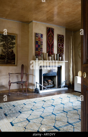 Fireplace with tribal ceramic display and wall hangings - Stock-Bilder