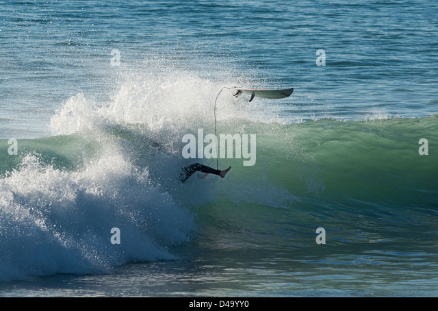 Surfer and wave. - Stock Image