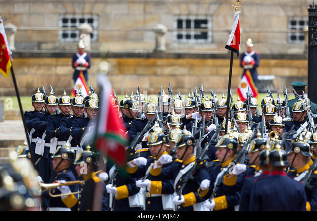 The ceremonial guard and marching military band arriving at the President's residence in Bogota, Colombia - Stock Image