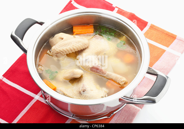 Chicken soup in stew pot on napkin - Stock Image