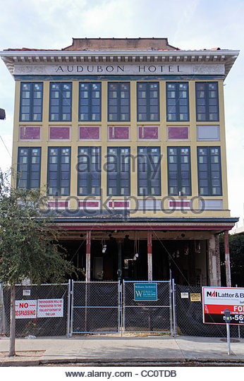 New Orleans Louisiana St. Charles Avenue Garden District Audubon Hotel renovation construction site windows architecture - Stock Image