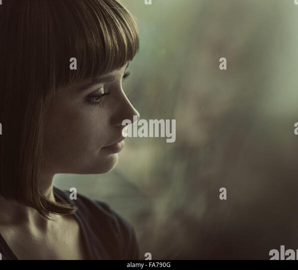 Portrait of a nostalgic brunette woman - Stock-Bilder