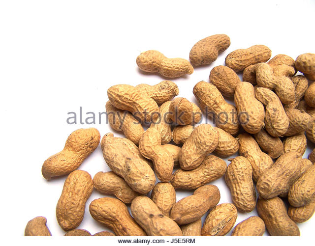 food aliment peanuts bowl crack calories oxidized legume containing fat - Stock Image