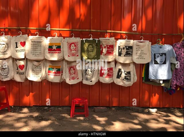 Rangun, Myanmar. 21st Feb, 2017. Bags with different pictures, including Aung San Suu Kyi, made in fair production, - Stock-Bilder