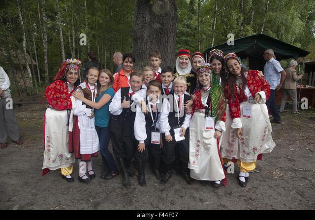 Folk dancers from various countries at an international folk arts festival pose together near Zielona Gora, Poland. - Stock-Bilder