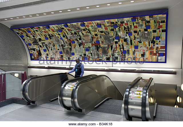 Atlanta Georgia Hartsfield-Jackson Atlanta International Airport escalator up down mural public art Black man Saints - Stock Image