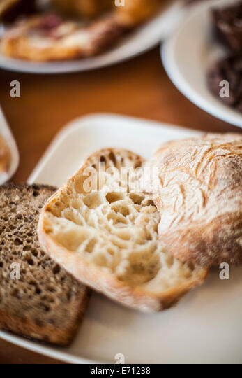 Sliced bread and ciabatta - Stock Image
