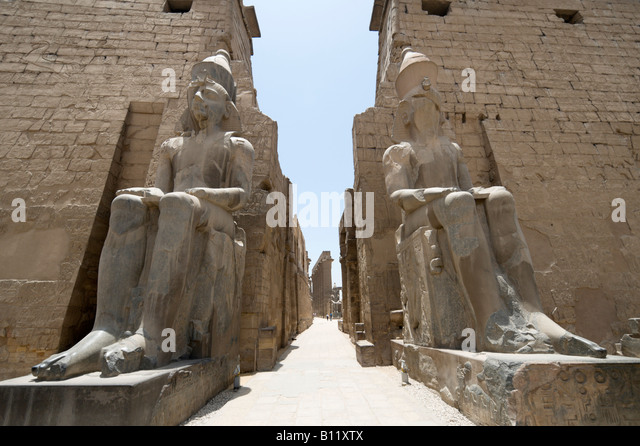 Colossi at Entrance to Court of Ramses II, Luxor Temple, Luxor, Nile Valley, Egypt - Stock Image