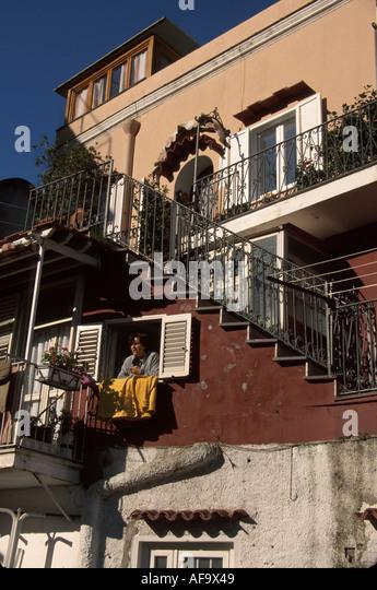Italy Isle of Capri Tyrrhenian Sea Capri Town Marina Grande apartment building female resident window - Stock Image