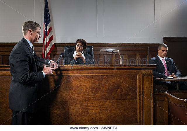 A lawyer and judge talking - Stock Image