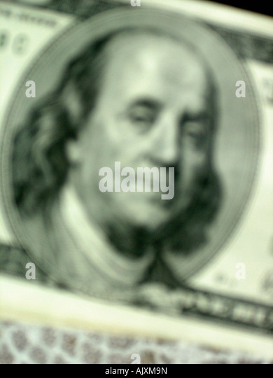 Blurred Closeup of Benjamin Franklin on the Face of a USA One Hundred Dollar $100 Bill - Stock Image