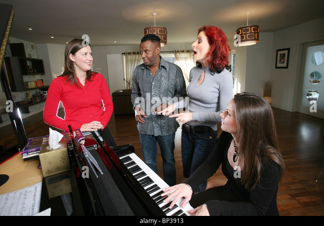 Vocal coaches giving a woman a singing lesson, London, England, UK. Photo:Jeff Gilbert - Stock Image