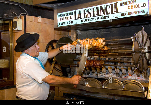 Argentine man cooking meat for a restaurant in Buenos Aires Argentina - Stock Image