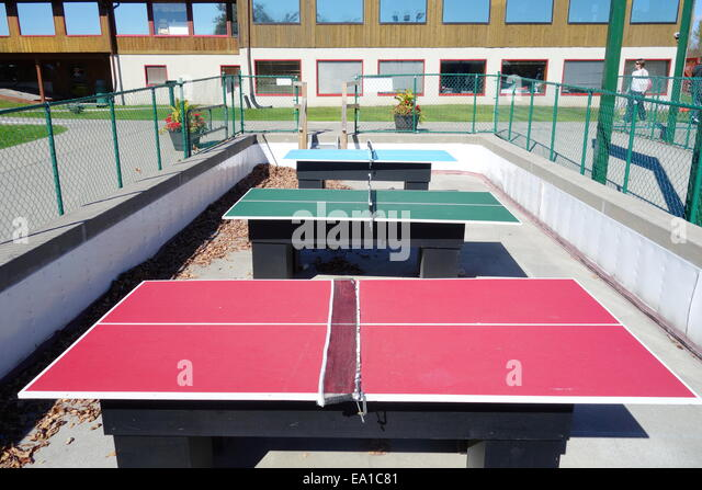 Table tennis tables in a park in Toronto, Canada - Stock Image
