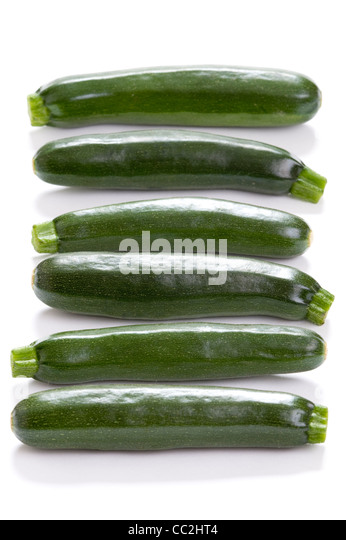 courgette or zucchini isolated on a white studio background - Stock Image