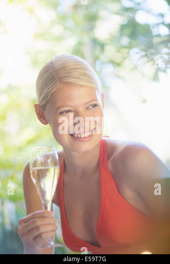 Woman drinking wine outdoors - Stock Image