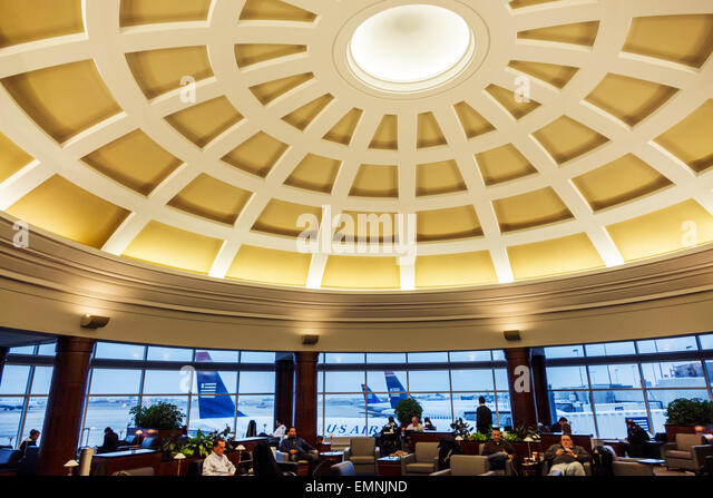 Charlotte North Carolina Charlotte Douglas International Airport CLT terminal concourse gate area US Airways Club - Stock Image
