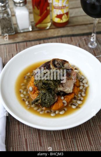 Cajun Cuisine, Ham Hock with Sweet Potatoes, Pickled Greens & Black Eye Pea Ham Broth, Cochon Restaurant, New - Stock Image