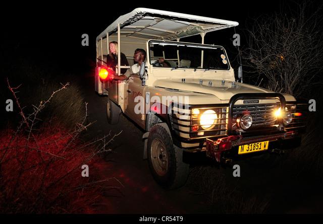 Night safari with a ranger of the Namibia Wildlife Resorts, near the Onkoshi Camp, Etosha National Park, Namibia, - Stock-Bilder