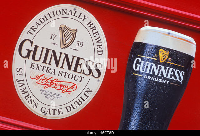 Poster advertisement billboard alcohol stock photos for Guinness beer in ireland