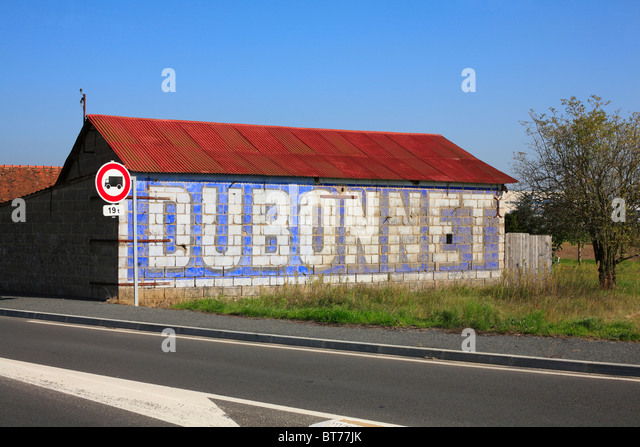 Dubonnet Advertisement Painted on a Wall near Cheverny in the Loire Valley, France. - Stock Image