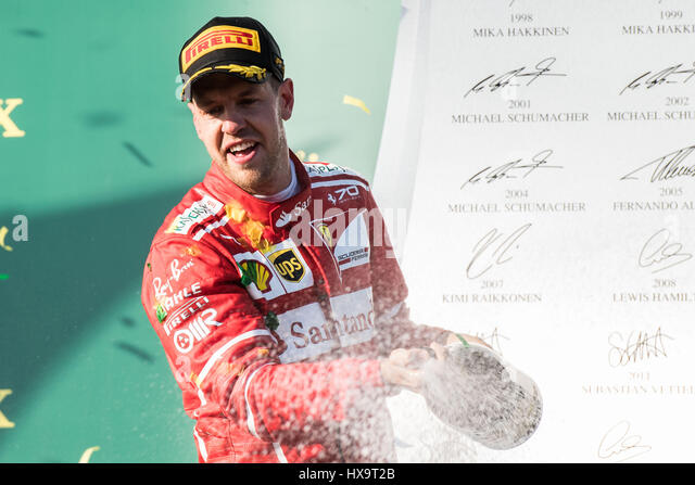 Melbourne, Australia. 26th Mar, 2017. Scuderia Ferrari's German driver Sebastian Vettel celebrates during the - Stock Image