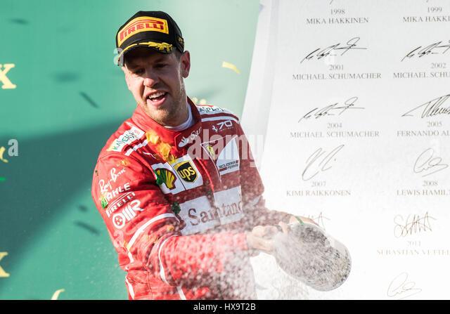 Melbourne, Australia. 26th Mar, 2017. Scuderia Ferrari's German driver Sebastian Vettel celebrates during the - Stock Image