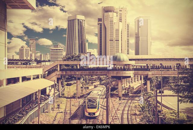 Retro stylized photo of a modern city, Kuala Lumpur, Malaysia. - Stock Image