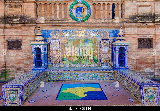 Glazed tiles bench of spanish province of Santander at Plaza de Espana, Seville, Spain - Stock Image