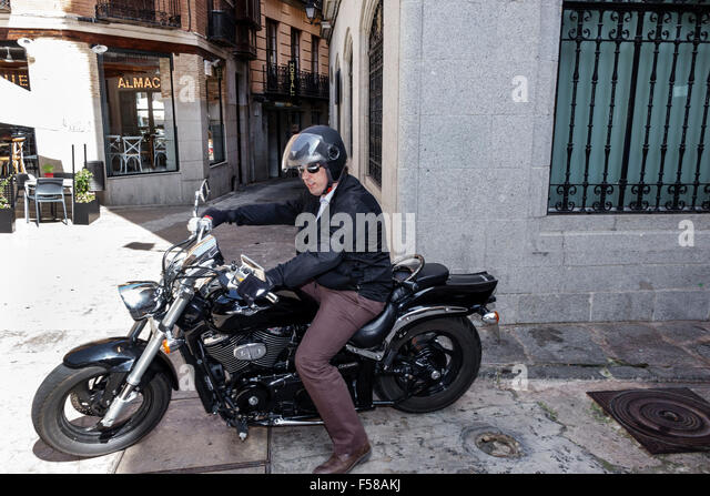 Spain Europe Spanish Toledo Hispanic man motorcycle riding - Stock Image