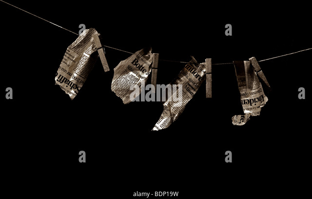 Newspaper cuttings hanging on a washing line - Stock Image