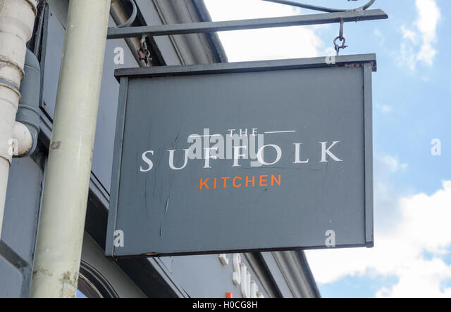 Hanging sign for The Suffolk Kitchen restaurant in Suffolk Parade, Cheltenham - Stock Image