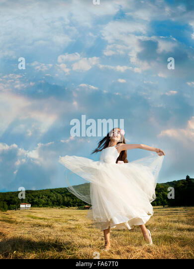 vertical, outdoors, day, real people, one person, girls, one girl only, children, one child only, 8-9 years, elementary - Stock Image