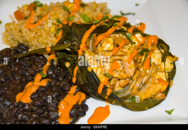 Chili chicken relleno with black beans and rice on white plate mexican food tex-mex cuisine san antonio texas tx - Stock Image