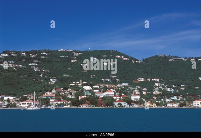 St Thomas USVI Charlotte Amalie harbor scenic landscape viewed from a cruise ship sailboats hillside - Stock Image