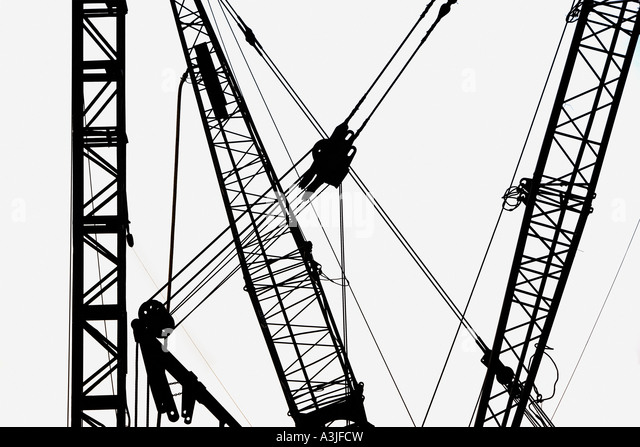 Cranes in silhouette - Stock Image