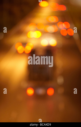 Blurred night freeway traffic - Stock Image