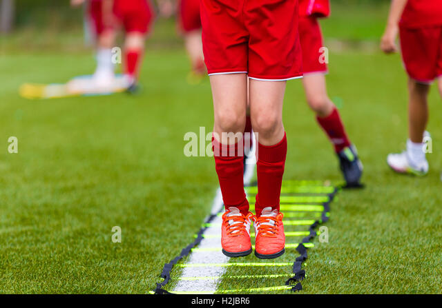 Ladder Drills Exercises for Football Soccer team. Young Players Exercises On The Ladder Drills. Football Youth Training - Stock Image