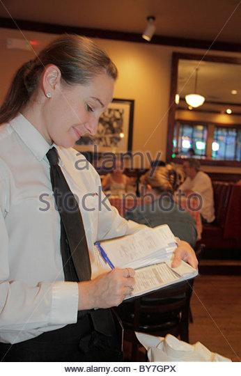 Philadelphia Pennsylvania Maggiano's Little Italy Italian restaurant fine dining ethnic woman waitress takes - Stock Image