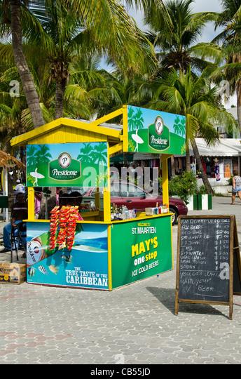 St Maarten Philipsburg Front Street green Presidente beer stand - Stock Image