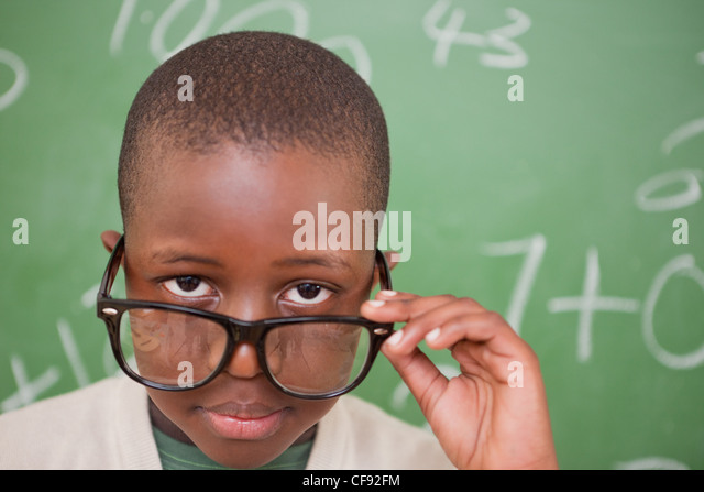 Schoolboy looking over his glasses - Stock Image