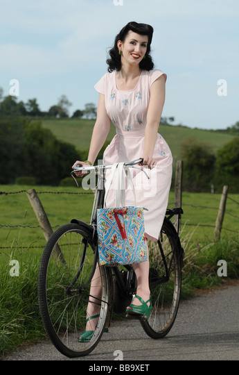 Woman on a bicycle - Stock-Bilder