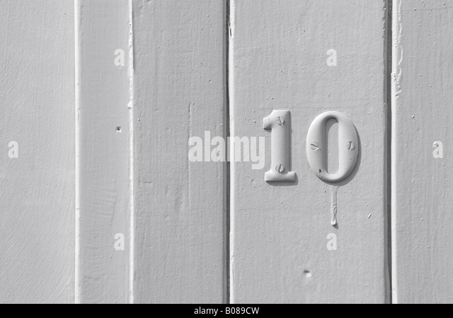 number ten 10 on white timber clad door - Stock Image