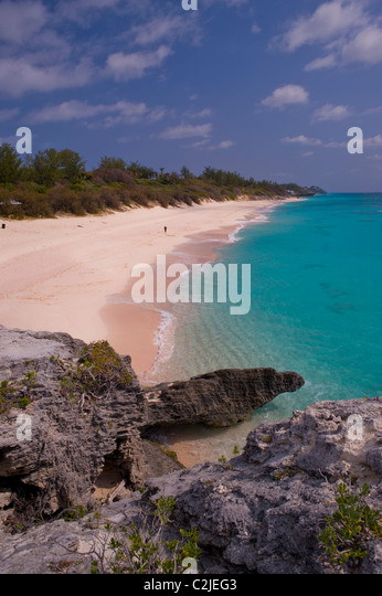 A solitary man runs on a deserted South Coast beach, Warwick parish, Bermuda. - Stock Image