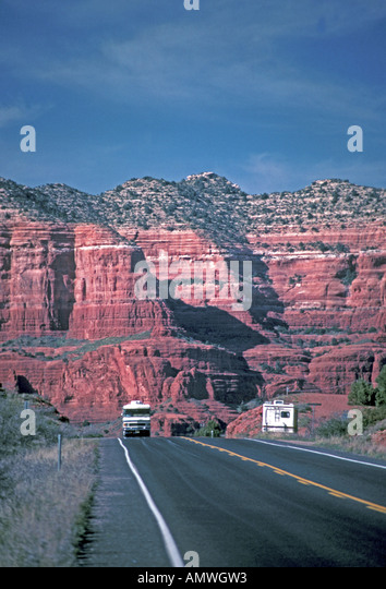 Arizona red towering cliff couple recreational vehicle rv - Stock Image