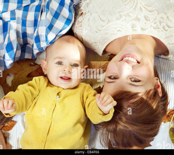 Attractive mom with lovely baby - Stock Image