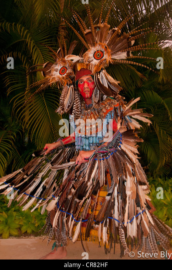 A Mayan fokllore ritual is performed by a maya performer in traditional dress, Riviera Maya, Mexico - Stock Image