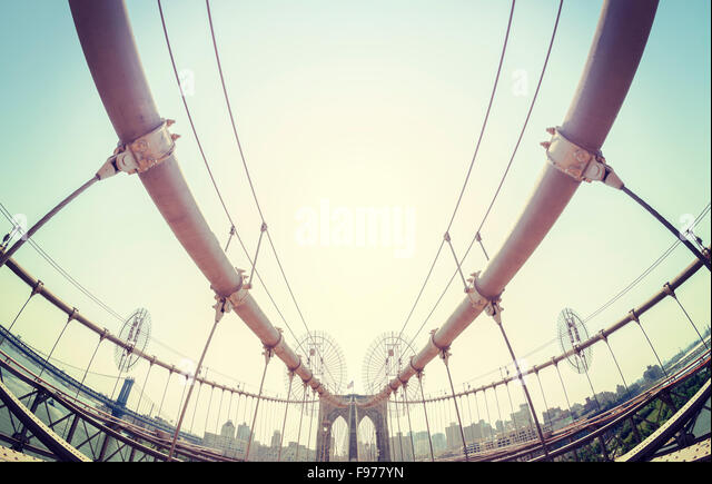 Vintage toned fisheye lens picture of the Brooklyn Bridge in New York City, USA. - Stock Image